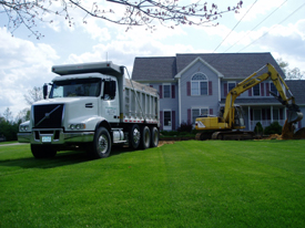Septic Truck and Excavator at Installation